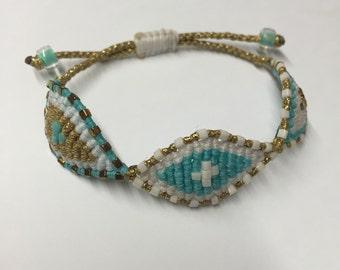 Triple eye bracelet, gold white and turquoise