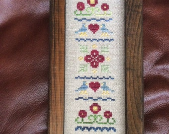 Stitched and Framed Cross Stitch Sampler