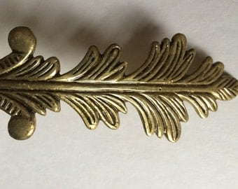 Pair of Brass/Gold Curtain Tie Back. Feather Motif