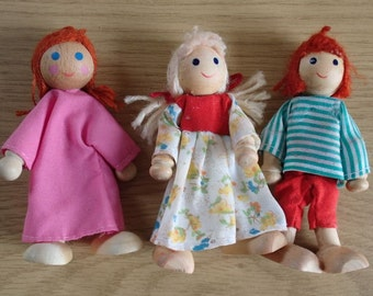 Three Lovely Wooden Dolls with Moveable Arms and Legs