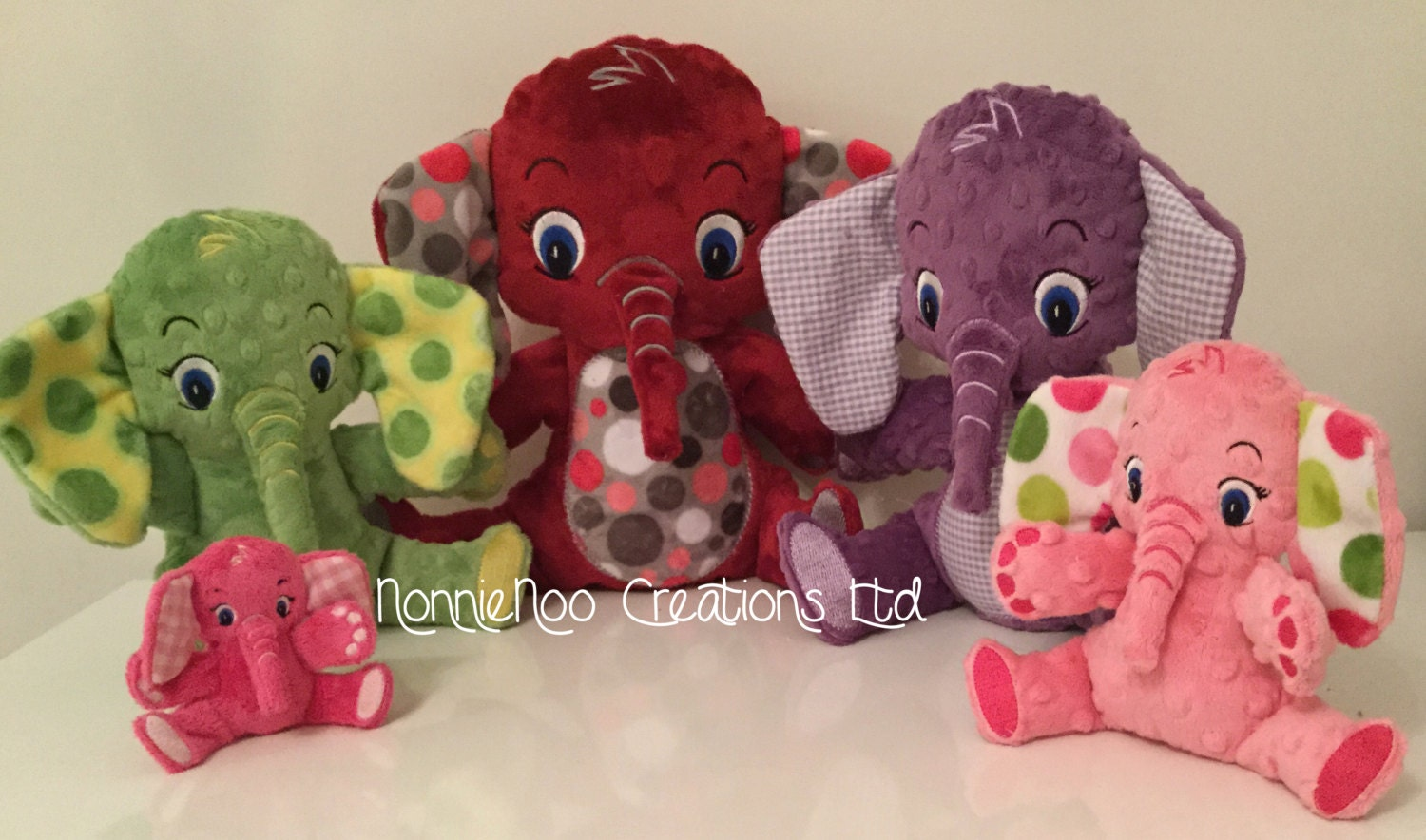 The elephant family machine embroidery ith