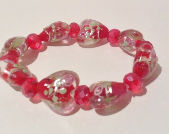 Bracelet.19cm. Features large High Quality Lampwork Glass hearts. Red/clear Green and pink floral and leaf pattern