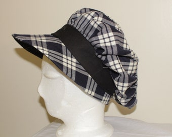 Tartan cap with pleats all around and big visier