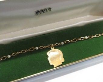 A.J.C Co 12K GF Girls Silhouette Charm / Genuine Pearl Bracelet