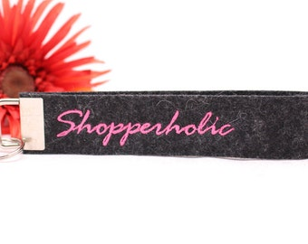 "Embroidered Keychain ""Shopperholic"" from dark gray heathered wool felt"