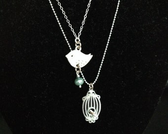 Sterling bird and cage necklace