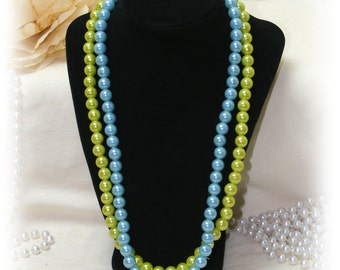 """Vintage """"FAUX PEARL NECKLACE . . 2 strands  (one in blue and one in green)"""