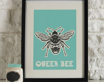 Aqua and black bee illustrated screen printed wall art, with 'Queen Bee' typography