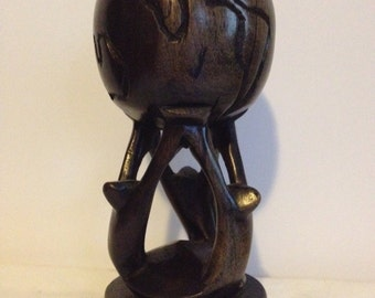 "Hand Carved ""Lift Up the World"" Statue"