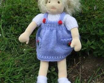 15 inch girl Waldorf doll with lambskin hair, knitted pinafore dress and party dress.