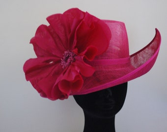 Magenta irregular shaped feature hat with silk poppy-- Style name Poppy