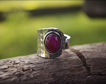 Ring silver with stone. Tribal jewelry. Ruby colored stone.