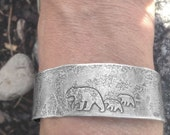 Mama Bear with her cubs cuff bracelet.. Silver over brass.. Hand etched and forged.