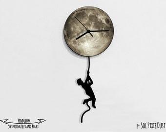 Boy climbing on the Moon - Pendulum Wall Clock