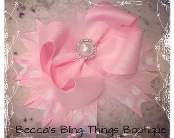 Sweet pink hairbow with pearl center.