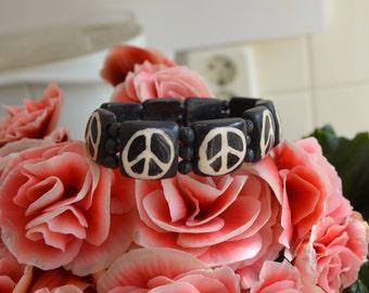 Beautiful PEACE sign stretch bracelet handmade with bone beads.
