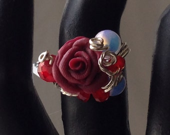 RR21S  Burgandy rose ring with opaque crystals, wrapped in silver wire, size 8