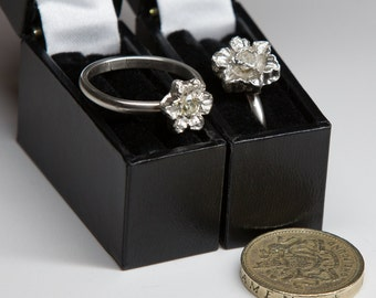 Silver ring with silver flower set with clear spinel gemstone