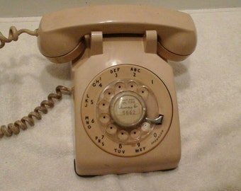 Vintage antique tan rotary dial phone