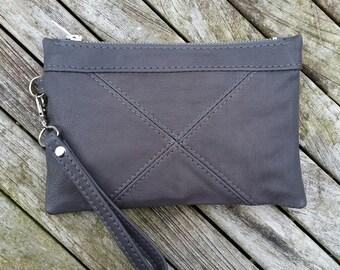 Grey leather clutch bag