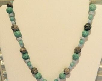 Birds nest pendant necklace