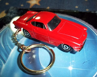 custom made stock-refit keychain,1969 volvo p1800-s coupe,gloss red w/black tires on chrome hub caps /mint