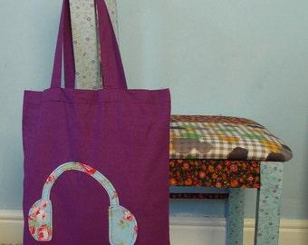 Purple canvas tote bag with applique headphones motif