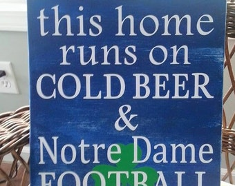 Notre Dame**Fightin Irish**WOOD sign**This home runs on cold beer and ND football**So FUN**Great gift!