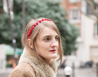 Headband with red PomPoms