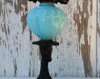 Vintage Metal Bird Claw Candlestick with Blue Glass Globe