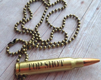 223 Bullet Casing with Top Shot and a Bullseye Etched into the Casing