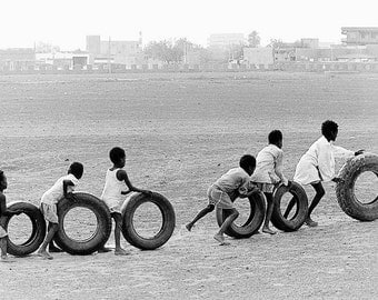 Children playing, Khartoum Sudan 1989 Africa, Fine Art Print signed and embossed by Mirko Krizanovic, tires roll