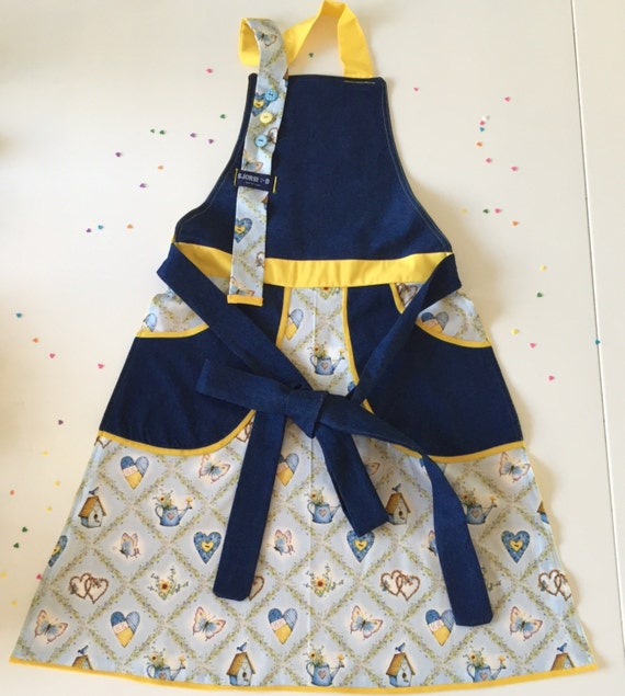 Denim Holly Hobbie light blue and sunny yellow retro style women's apron with deep pockets.