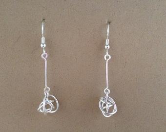Sterling silver long dangle love knot earrings .