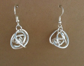 Silver large knot dangle earring.