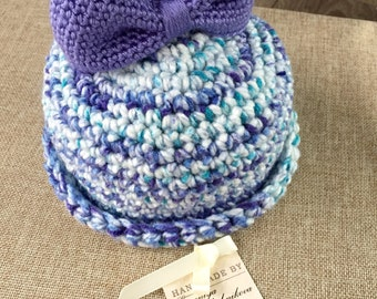 Bell hat with blue bow