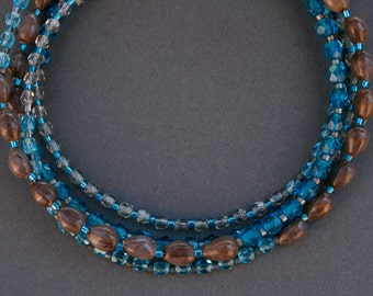long beaded necklace with natural seeds and bright blue glass beads - boho jewelry - thin layering necklace