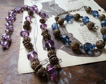 Blue and Purple Faceted Glass Beaded Necklaces with Cricket Cage Like Metal Beads