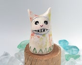 White Clay Monster Figurine with Pink and Green