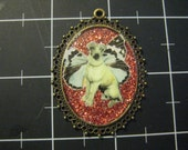 Darling Flutterpup Pendant, 50% of the proceeds go to the current selected animal charity