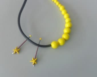 Yellow rubber asymmetric statement necklace starfish
