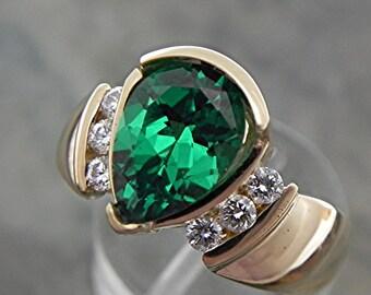AAAA Tsavorite Garnet Lab Grown   10x7mm  2.98 Carats   14K Yellow Gold engagement ring with .20 ct diamonds 1588