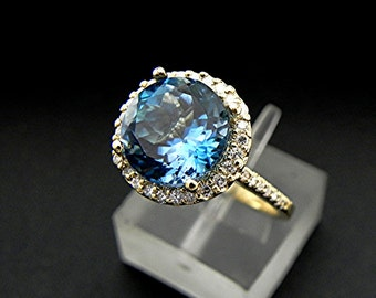 AAAA London Blue Topaz   9mm  3.40 Carats   in 14K Yellow gold Halo ring with  .35 carats of diamonds 2140 Y