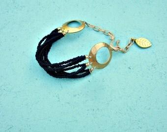 Adjustable Matte Black Glass Multi Strand Beaded Bracelet with Gilt Accents: Pindar WAS 15.00