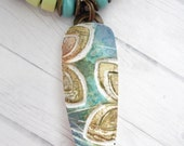 Polymer Clay Pendant featuring Tropical Bohemian Teal, Gold and White Batik Abstract Leaf Design