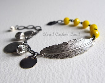 Boho Bracelet with Oxidized Silver Feather Bright Yellow Glass Beads and Silver Disc and Bits Street Style Boheme Chic
