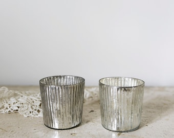 two mercury glass tea light holders