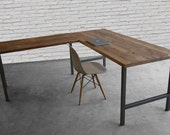 Custom desk made in L shape with reclaimed wood and hand welded steel legs