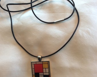 Mondrian abstract pendant on leather cord