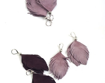 Set of two pairs feather earrings from dark violet and smoky violet suede leather.
